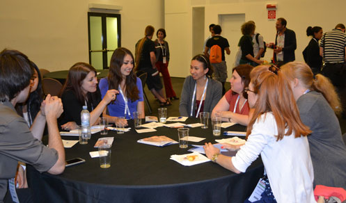 Participants at FENS Forum 2014 Italy sitting at a table