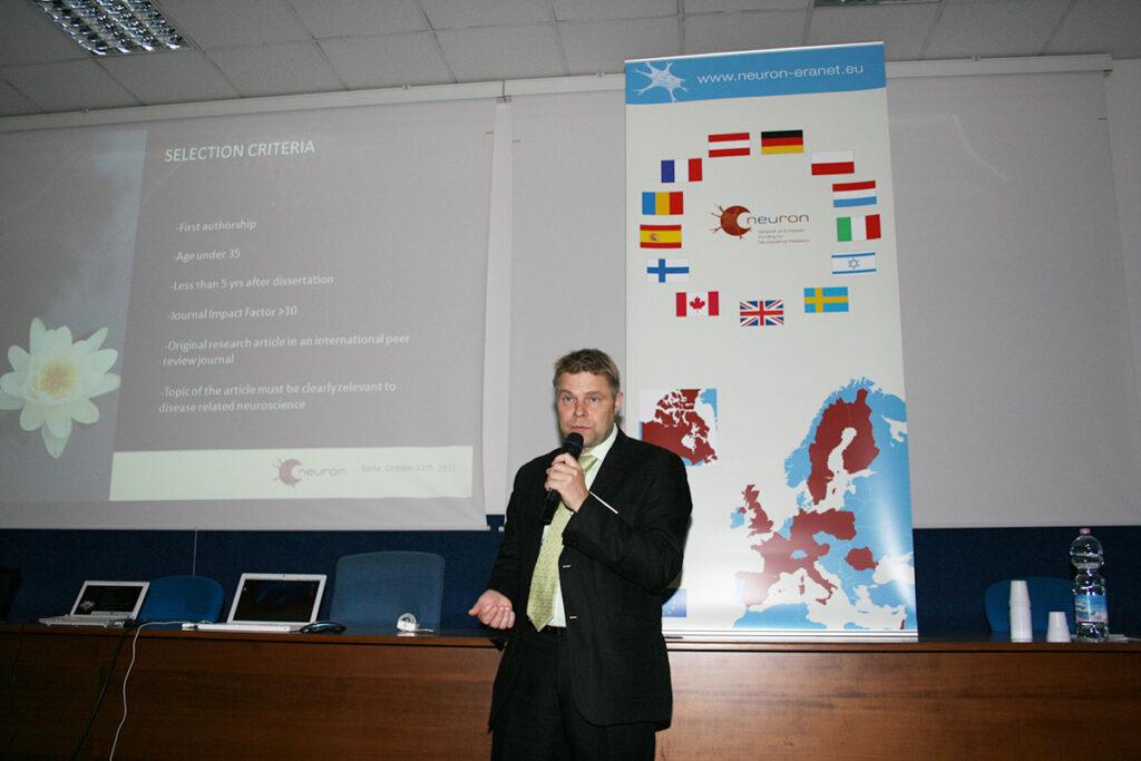 Dr. Erkki Raulo giving a presentation